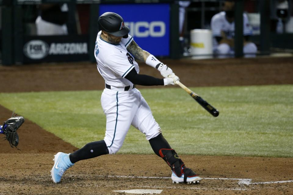 Arizona Diamondbacks' Christian Walker connects for a three-run double against the Los Angeles Dodgers during the eighth inning of a baseball game Friday, July 31, 2020, in Phoenix. (AP Photo/Ross D. Franklin)
