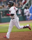 Cleveland Indians' Jose Ramirez runs the bases after hitting a solo home run during the first inning of the team's baseball game against the Baltimore Orioles, Wednesday, June 16, 2021, in Cleveland. (AP Photo/Tony Dejak)