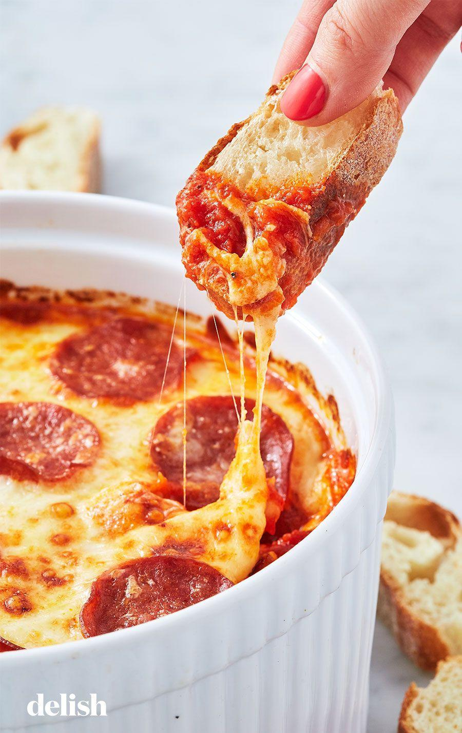"""<p>Meet the party app of your (cheese-filled) dreams.</p><p>Get the recipe from <a href=""""https://www.delish.com/cooking/recipe-ideas/a26001169/pizza-dip-recipe/"""" rel=""""nofollow noopener"""" target=""""_blank"""" data-ylk=""""slk:Delish"""" class=""""link rapid-noclick-resp"""">Delish</a>.</p>"""