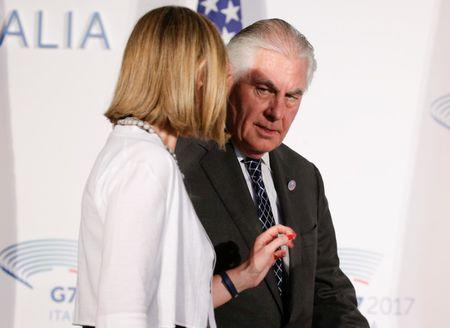 U.S. Secretary of State Rex Tillerson talks with E.U. High Representative for Foreign Affairs Federica Mogherini as they arrive to pose for a family photo during a G7 for foreign ministers in Lucca