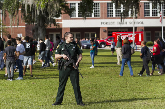 <p>A Marion County Sheriff's Deputy stands outside Forest High School as students exit the school after a school shooting occurred, Friday, April 20, 2018 in Ocala, Fla. (Photo: Doug Engle /Star-Banner via AP) </p>