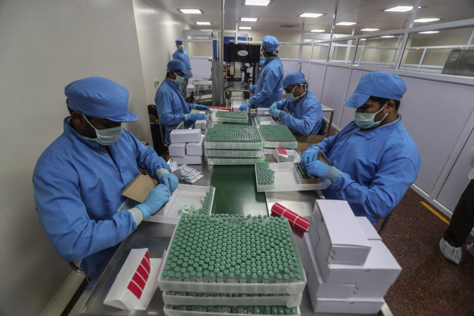 FILE- In this Jan. 21, 2021, file photo, employees pack boxes containing vials of Covishield, a version of the AstraZeneca vaccine at the Serum Institute of India in Pune, India. India, the world's largest maker of vaccines, was expected to play a pivotal role in global efforts to immunize against COVID-19. But its own capacity is proving to be insufficient for its own massive needs amid a ferocious surge of new infections. In past weeks, many people wanting to get vaccines have been turned away. Experts say that this is due to bad planning. (AP Photo/Rafiq Maqbool, File)