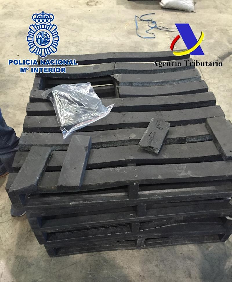 This handout image released on December 11, 2015 by the Spanish Police shows fake wood pallets imported from Colombia and made of narcotic drug cocaine