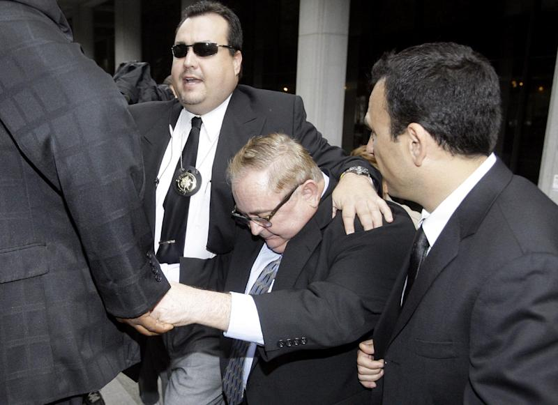 FILE - In this Oct. 21, 2010 file photo, Former Bell, Calif., city manager Robert Rizzo, is escorted from court by bodyguards after an arraignment on corruption charges, in Los Angeles. Los Angeles County district attorney says the former city manager of suburban Bell, Calif., has pleaded no contest to all 69 counts in a massive public corruption case and will be sentenced to 10 to 12 years in prison. District Attorney Jackie Lacey says Robert Rizzo entered the plea Thursday, Oct. 3, 2013 and it was not a negotiated settlement. (AP Photo/Reed Saxon, File)
