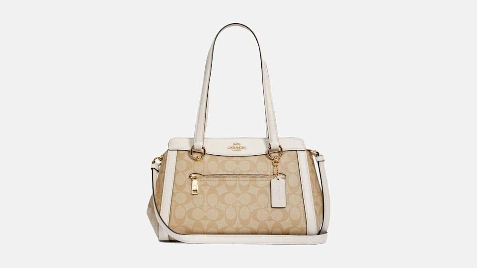 A classic shoulder bag is a wardrobe must-have, and this Coach signature print carryall is deeply discounted.