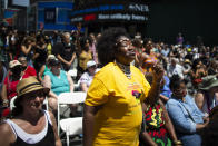 People attend a free outdoor event organized by The Broadway League as celebrations during Juneteenth take place at Times Square Saturday, June 19, 2021, in New York. Parades, picnics and lessons in history marked Juneteenth celebrations in the U.S., a day that marks the arrival of news to enslaved Black people in a Texas town that the Confederacy had surrendered in 1865 and they were free. (AP Photo/Eduardo Munoz Alvarez)