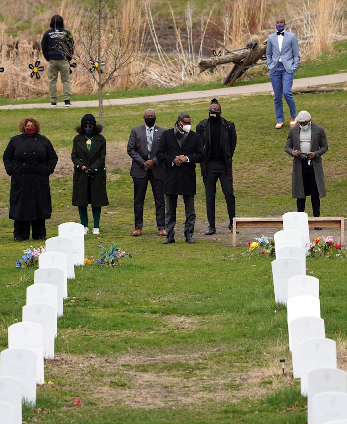 """Derrick Johnson, the president of the NAACP, center, visits the """"Say Their Names"""" memorial in Minneapolis on April 19, 2021.<span class=""""copyright"""">Trevor Hughes—USA Today/Reuters</span>"""