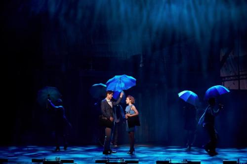 The stage is designed with four thematic scenes with dazzling backdrops.