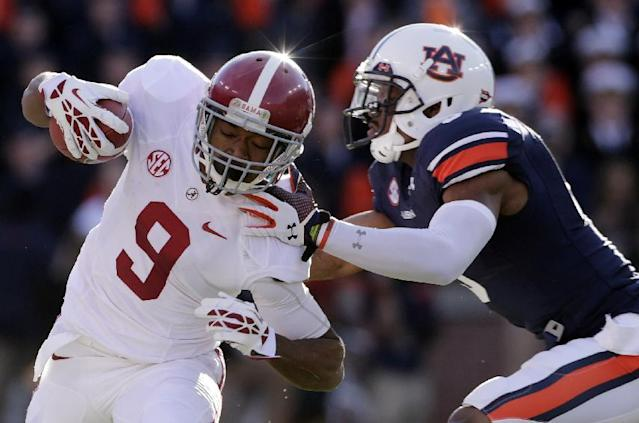 FILE - In the Nov. 30, 2013, file photo, Auburn linebacker Jake Holland (5) pushes Alabama wide receiver Amari Cooper (9) out-of-bounds during the first half of an NCAA college football game in Auburn, Ala. Alabama is hoping for another powerful rebound to once again go from a big beating in the Big Easy, to national dominance. (AP Photo/Dave Martin, File)