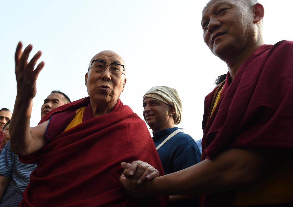 The 14th Dalai Lama announced a new iPhone app which will allow devotees to watch live video of his teachings to his 16.6 million Twitter followers on Thursday (AFP Photo/INDRANIL MUKHERJEE        )
