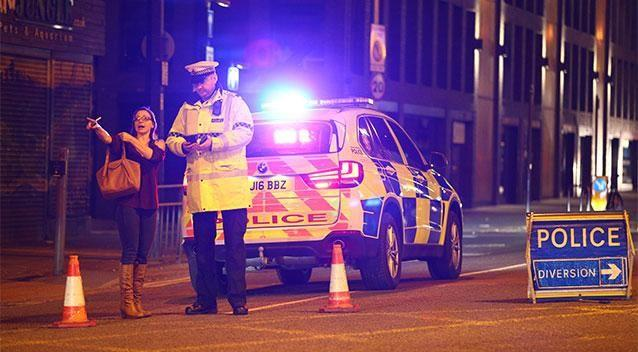 A woman speaks to police in Manchester. Photo: Getty Images