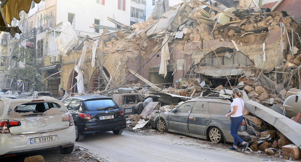 Damaged buildings and vehicles in the aftermath of a massive explosion in Beirut, Lebanon.