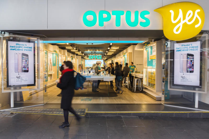 Melbourne, Australia - August 6, 2015: A woman walks past an Optus store on Bourke St. Optus is the second largest telecommunications company in Australia.