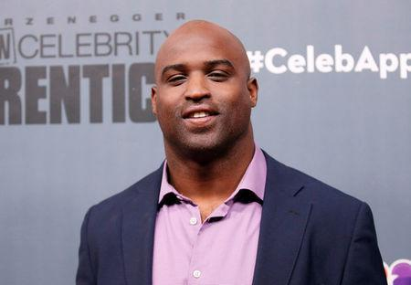"FILE PHOTO: Cast member Ricky Williams poses after a panel for ""The New Celebrity Apprentice"" in Universal City, California, December 9, 2016. REUTERS/Danny Moloshok"