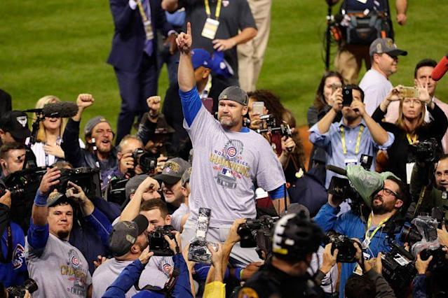 """<a class=""""link rapid-noclick-resp"""" href=""""/mlb/players/6956/"""" data-ylk=""""slk:David Ross"""">David Ross</a> is carried off the field by his teammates after the Cubs won Game 7 of the 2016 World Series. (Getty Images)"""
