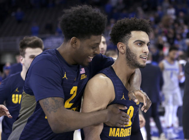 FILE - In this Jan. 9, 2019, file photo, Marquette's Sacar Anim (2), left, celebrates with Markus Howard (0) following the team's NCAA college basketball game against Creighton in Omaha, Neb., Howard was selected to The Associated Press All-America first team, Friday, March 20, 2020. (AP Photo/Nati Harnik)