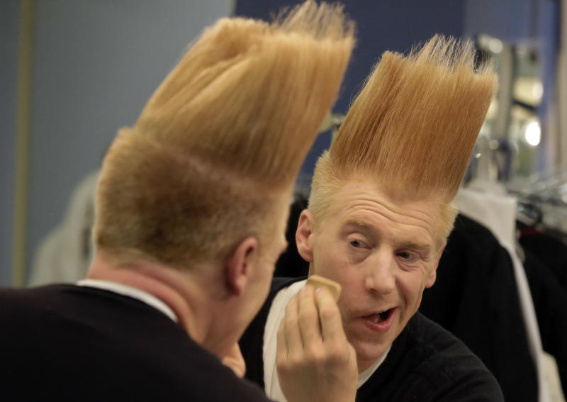 "This March 23, 2013 photo shows performer Bello Nock appling make-up in his dressing room as he prepares for his ""Bello Mania"" show at the New Victory Theater in New York. Nock, a seventh-generation circus performer, is never offstage during the 90-minute performance, which combines slapstick clowning with death-defying aerial stunts. He performs through March 31 at the New Victory before moving on to the Canadian side of Niagara Falls and then a 10-week stint at the Beau Rivage Casino in Biloxi, Miss. (AP Photo/Richard Drew)"