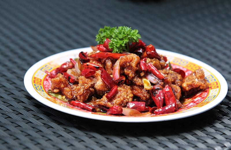 General FLS Tso's Chicken at Fu Lu Shou, a retro Chinese-Western bar/restaurant located on Hollywood Road in Central. 21AUG14 [48HRs RESTAURANT REVIEW] (Photo by Bruce Yan/South China Morning Post via Getty Images)