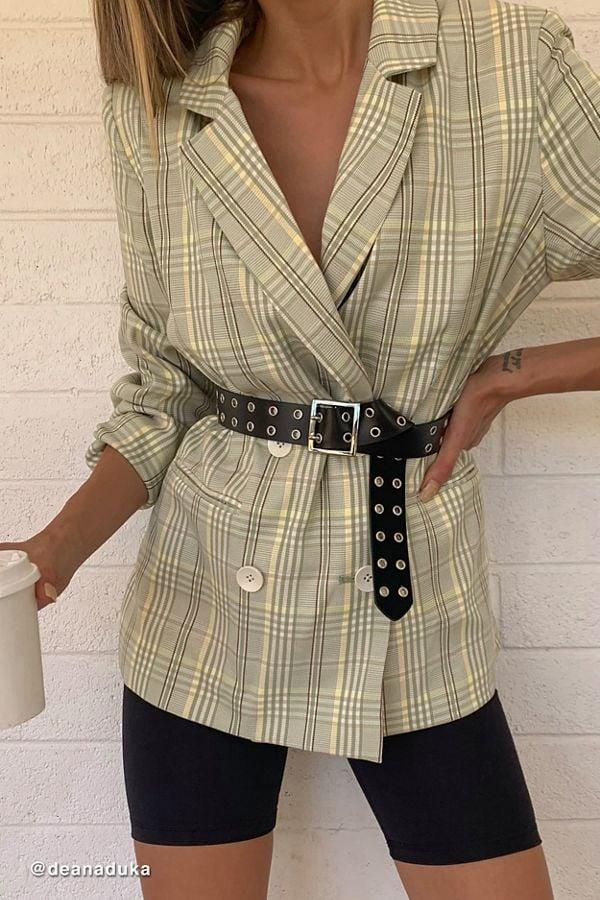 """<p>Style this <a href=""""https://www.popsugar.com/buy/UO-Plaid-Oversize-Double-Breasted-Blazer-484165?p_name=UO%20Plaid%20Oversize%20Double-Breasted%20Blazer&retailer=urbanoutfitters.com&pid=484165&price=119&evar1=fab%3Aus&evar9=46542070&evar98=https%3A%2F%2Fwww.popsugar.com%2Ffashion%2Fphoto-gallery%2F46542070%2Fimage%2F46542077%2FUO-Plaid-Oversize-Double-Breasted-Blazer&list1=shopping%2Cfall%20fashion%2Cblazers%2Cfall&prop13=mobile&pdata=1"""" rel=""""nofollow"""" data-shoppable-link=""""1"""" target=""""_blank"""" class=""""ga-track"""" data-ga-category=""""Related"""" data-ga-label=""""https://www.urbanoutfitters.com/shop/uo-plaid-oversized-double-breasted-blazer?category=SEARCHRESULTS&amp;color=038"""" data-ga-action=""""In-Line Links"""">UO Plaid Oversize Double-Breasted Blazer</a> ($119) with a cute belt.</p>"""