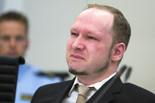 Rightwing extremist Anders Behring Breivik, who killed 77 people in twin attacks in Norway last year, shares a tear as court views propaganda film he made, during his trial in Oslo courthouse