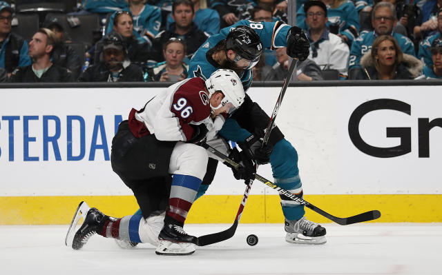 Colorado Avalanche right wing Mikko Rantanen (96) and San Jose Sharks defenseman Brent Burns (88) battle for the puck during the second period of Game 7 of an NHL hockey second-round playoff series in San Jose, Calif., Wednesday, May 8, 2019. (AP Photo/Josie Lepe)