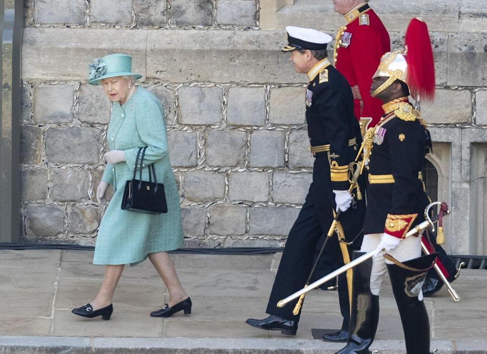"<p>Per <a href=""https://www.hellomagazine.com/fashion/royal-style/2020061391494/queen-stuns-stewart-parvin-floral-dress-trooping-the-colour/"" rel=""nofollow noopener"" target=""_blank"" data-ylk=""slk:Hello!"" class=""link rapid-noclick-resp""><em>Hello!</em></a>, Queen Elizabeth wore ""a muted jade outfit by Stewart Parvin"" for the occasion. The publication also noted that Her Majesty wore her Welsh Guards brooch for the ceremony, and a floral dress.</p>"