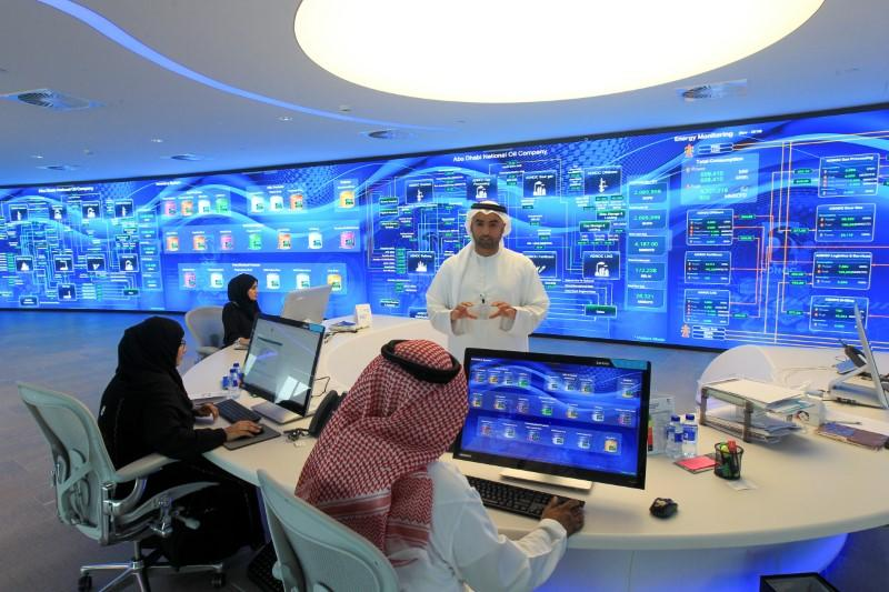 Employees are seen at the Panorama Digital Command Centre at the ADNOC headquarters in Abu Dhabi