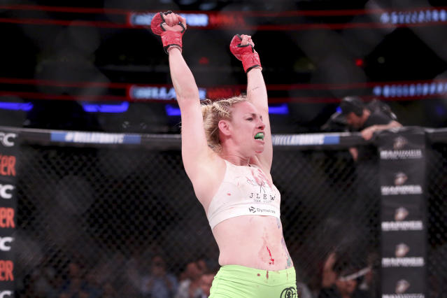 Heather Hardy celebrates a win against Alice Yauger in a mixed martial arts bout at Bellator 180. (AP)