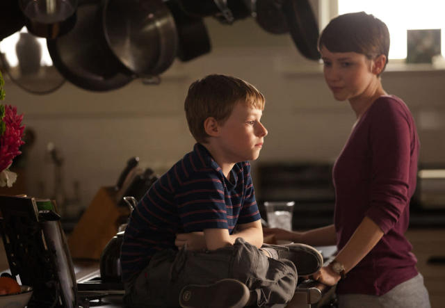 "Joey Matthew's (Kyle Catlett) babysitter, Denise (Valorie Curry), tries to distract him from all the commotion in the series premiere of ""The Following."""
