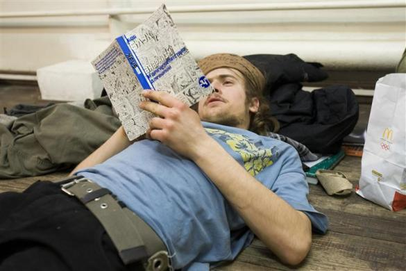 Political activist Pyotr Verzilov, the husband of Pussy Riot member Nadezhda Tolokonnikova, reads a book about anarchism by the U.S. author Bob Black in Moscow, January 16, 2009.