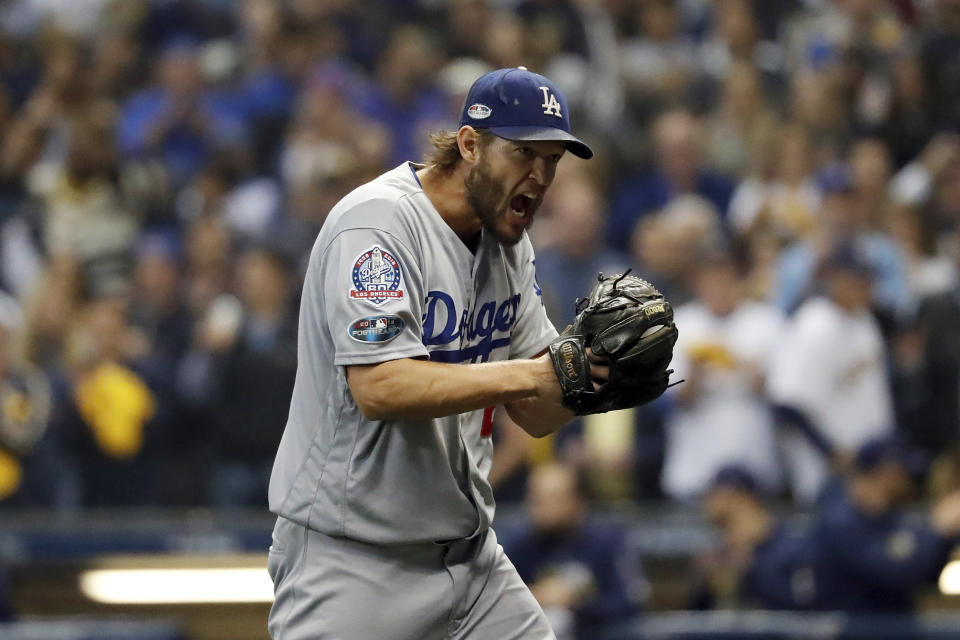 Los Angeles Dodgers starting pitcher Clayton Kershaw (22) yells as he walks off after the third inning of Game 1 of the National League Championship Series baseball game against the Milwaukee Brewers Friday, Oct. 12, 2018, in Milwaukee. (AP)