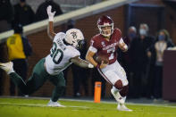 Oklahoma quarterback Spencer Rattler (7) is pursued by Baylor linebacker Hakeem Vance (30) in the first half of an NCAA college football game Saturday, Dec. 5, 2020, in Norman, Okla. (AP Photo/Sue Ogrocki)