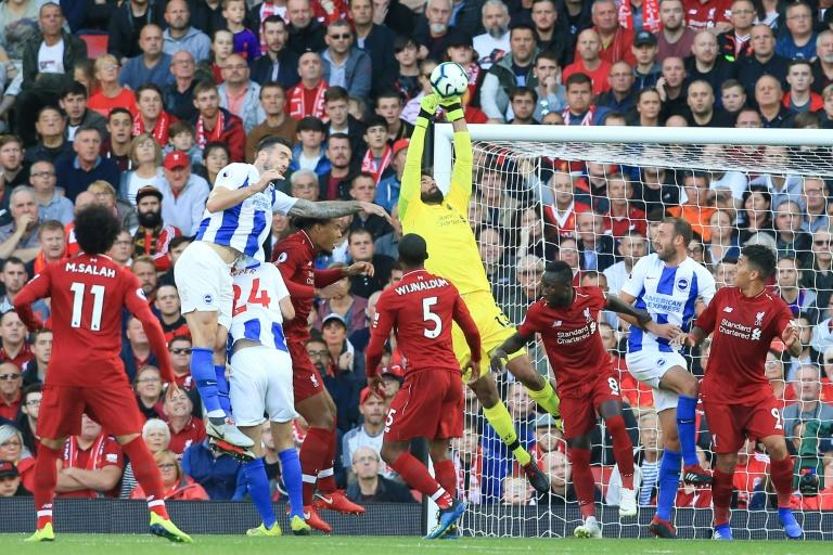 Liverpool goalkeeper Alisson claims the ball during the Premier League match against Brighton
