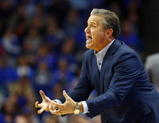 Kentucky coach John Calipari urges his team on during the second half of an NCAA college basketball game against Evansville in Lexington, Ky., Tuesday, Nov. 12, 2019. Evansville won 67-64. (AP Photo/James Crisp)