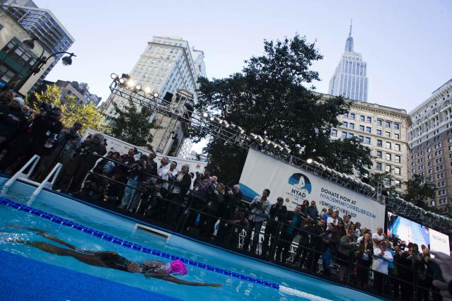 U.S. long-distance swimmer Diana Nyad begins her 48 hour continuous swim at Herald Square in New York October 8, 2013. According to a media release, Nyad is holding the 48 hour continuous swim to support Hurricane Sandy recovery efforts. The Empire State Building is seen in the background.. REUTERS/Eduardo Munoz (UNITED STATES= - Tags: SPORT DISASTER SWIMMING TPX IMAGES OF THE DAY)