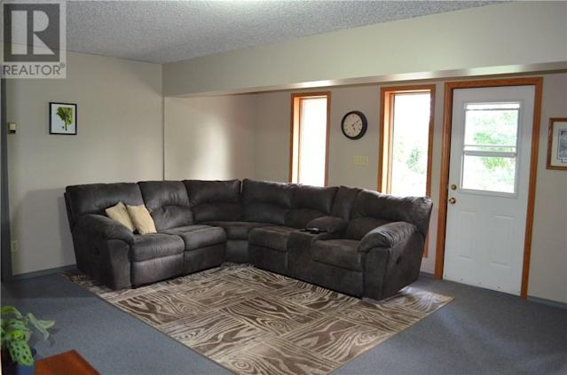 <p><span>5 Saskatoon Highway 5 East Acreage, Saskatoon, Sask.</span><br> Downstairs, there is a walkout to the spacious backyard. The property also has a heated workshop that includes its own bathroom, plus several other storage buildings.<br> (Photo: Zoocasa) </p>