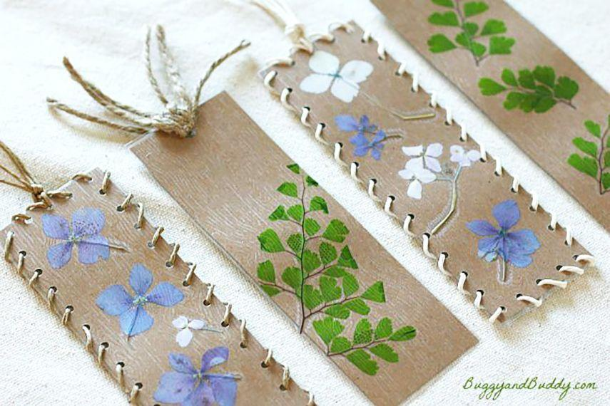 "<p>Go on a walk with the kids to collect small flowers and leaves, which you'll then dry and press onto light brown card stock. These precious floral bookmarks make a beautiful gift for Mom, and the kids will love making them, too.</p><p><strong>Get the tutorial at <a href=""http://buggyandbuddy.com/bookmark-craft-for-kids-using-pressed-flowers-and-leaves/"" rel=""nofollow noopener"" target=""_blank"" data-ylk=""slk:Buggy And Buddy"" class=""link rapid-noclick-resp"">Buggy And Buddy</a>. </strong></p>"