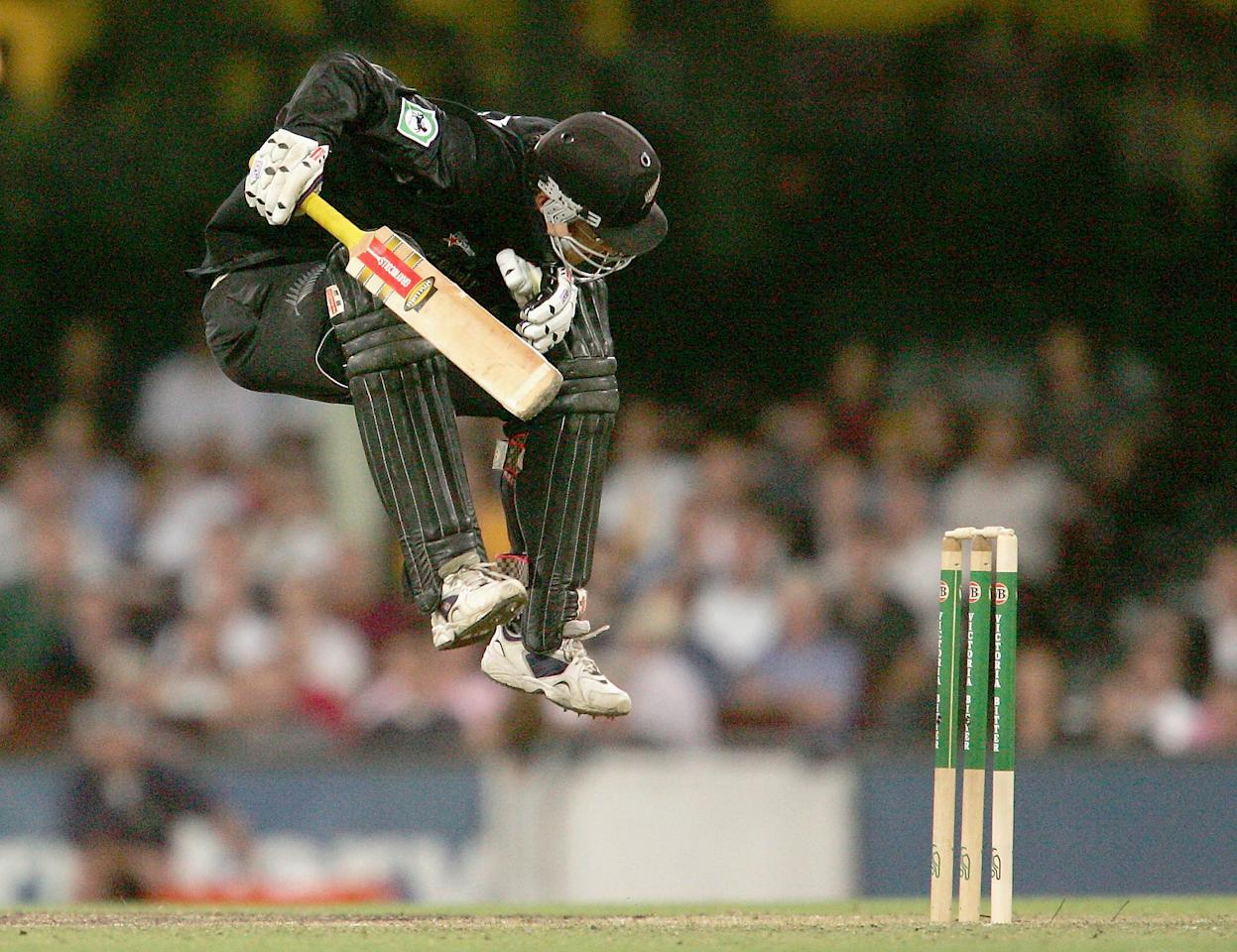 SYDNEY, AUSTRALIA - DECEMBER 8:  Daniel Vettori of New Zealand avoids a bouncer during game two of the Chappell-Hadlee Trophy between Australia and New Zealand played at the Sydney Cricket Ground, December 8, 2004 in Sydney, Australia. (Photo by Adam Pretty/Getty Images)