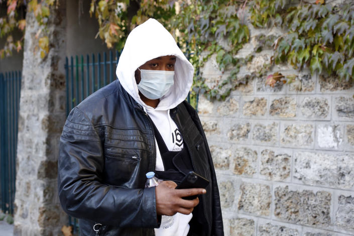 Music producer identified only by his first name, Michel, is pictured on his way to the Inspectorate General of the National Police, known by its French acronym IGPN, in Paris, Thursday, Nov. 26, 2020. French Interior Minister Gerald Darmanin ordered several Paris police officers suspended after the publication of videos showing them beating up a Black man and using tear gas against him with no apparent reason. (AP Photo/Thibault Camus)