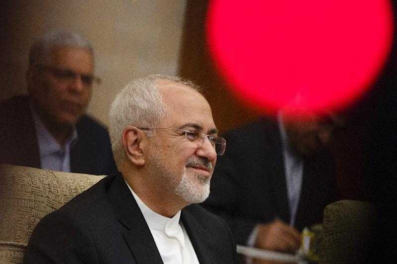 """""""We hope that with this visit to China and other countries we will be able to construct a clear future design for the comprehensive agreement,"""" Mohammad Javad Zarif told reporters after talks in Beijing with his Chinese counterpart Wang Yi (AFP Photo/THOMAS PETER)"""