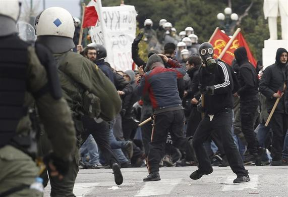 Riot police charge demonstrators during protests against planned reforms by Greece's coalition government in Athens, February 10, 2012.
