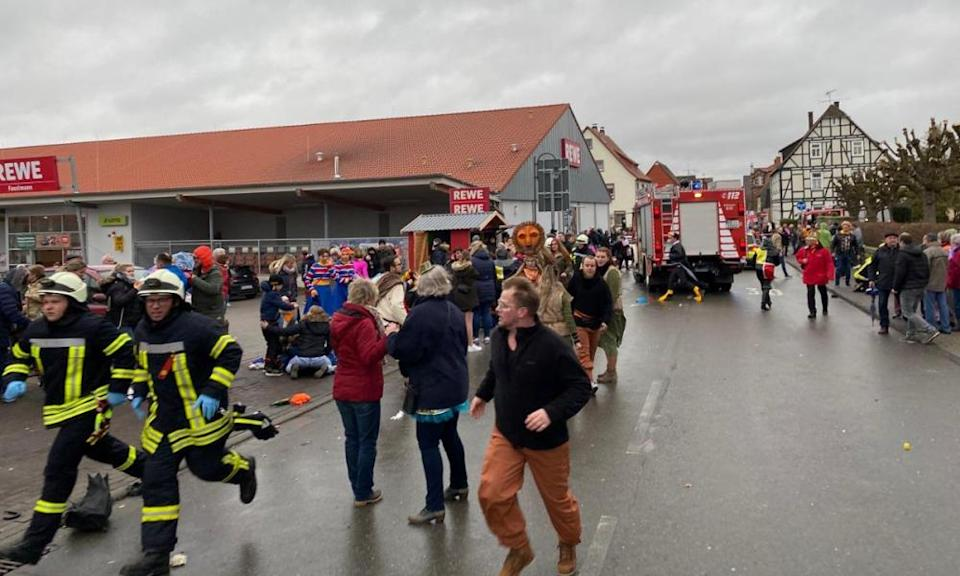 People react at the scene after a car ploughed into a carnival parade injuring several people in Volkmarsen, Germany February 24, 2020.