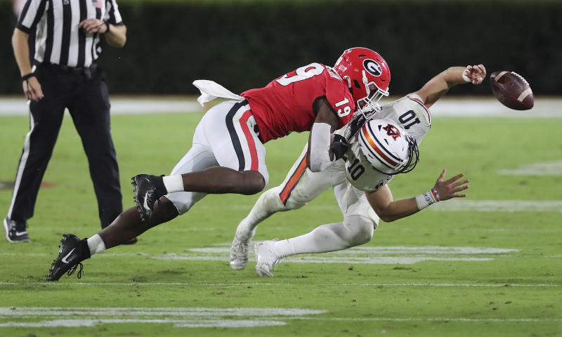 Georgia linebacker Adam Anderson levels Auburn quarterback Bo Nix, who was called for intentional grounding during the second half of an NCAA college football game Saturday, Oct. 3, 2020, in Athens, Ga. (Curtis Compton/Atlanta Journal-Constitution via AP)