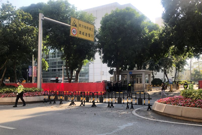 Police officers are seen outside a court in Shenzhen