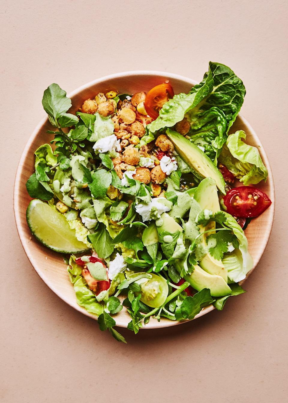 """<p>This dish is all about assembly, not time at the stove. Quickly sauté chickpeas and corn, then simply gather the supporting characters: lettuce, tomatoes, avocado, feta, and lime. </p>   <p><em>Like this</em> Bon Appétit <em>recipe? There are plenty more where this came from.</em> <a href=""""https://subscribe.bonappetit.com/subscribe/bonappetit/122921?source=HCL_BNA_SUBSCRIBE_LINK_0_EPICURIOUS_ZZ"""" rel=""""nofollow noopener"""" target=""""_blank"""" data-ylk=""""slk:Subscribe to the magazine here!"""" class=""""link rapid-noclick-resp""""><em>Subscribe to the magazine here!</em></a></p> <a href=""""https://www.epicurious.com/recipes/food/views/corn-and-chickpea-bowls-with-miso-tahini?mbid=synd_yahoo_rss"""" rel=""""nofollow noopener"""" target=""""_blank"""" data-ylk=""""slk:See recipe."""" class=""""link rapid-noclick-resp"""">See recipe.</a>"""