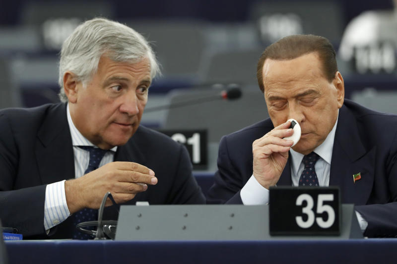 "Italy's Antonio Tajani, left, talks with Silvio Berlusconi during a session Wednesday, Sept. 18, 2019 at the European Parliament in Strasbourg, eastern France. The risk of Britain leaving the European Union without a divorce deal remains ""very real,"" European Commission chief Jean-Claude Juncker declared Wednesday as EU lawmakers debated the ramifications of a no-deal Brexit. (AP Photo/Jean-Francois Badias)"
