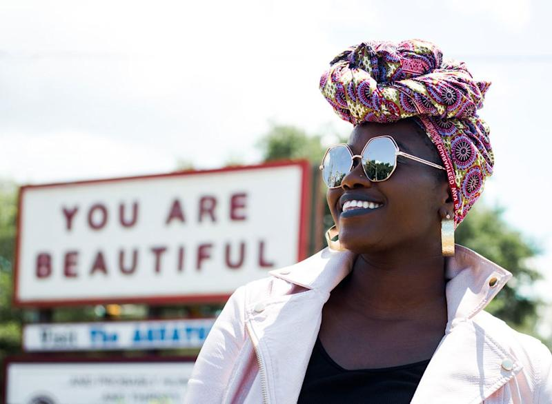 Woman smiling with sign you are beautiful