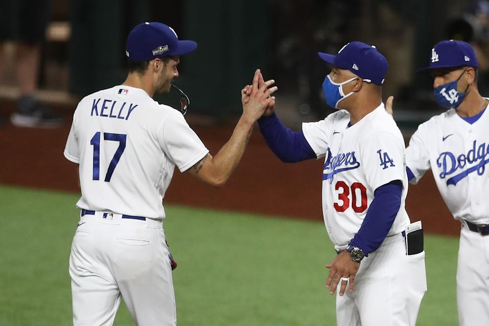 ARLINGTON, TEXAS - OCTOBER 07: Joe Kelly #17 of the Los Angeles Dodgers celebrates with manager Dave Roberts after defeating the San Diego Padres 6-5 in Game Two of the National League Division Series at Globe Life Field on October 07, 2020 in Arlington, Texas. (Photo by Ronald Martinez/Getty Images)