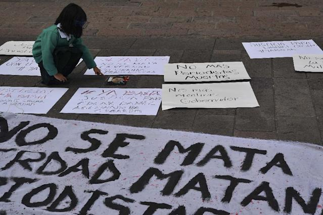 Mexican photojournalists demonstrated Friday to demand justice for their colleague Edgar Daniel Esqueda Castro (AFP Photo/YURI CORTEZ)