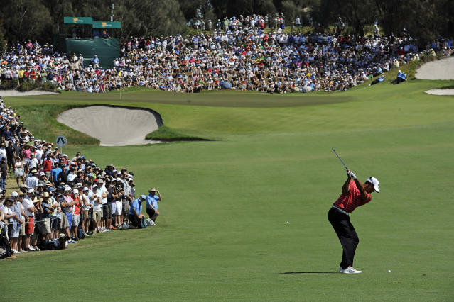 In this Nov. 18, 2011, file photo Tiger Woods hits an approach shot to the fourth hole during the second round of the Presidents Cup golf tournament at Royal Melbourne Golf Course, in Melbourne, Australia. Woods will captain the U.S. team at this year's Presidents Cup as Royal Melbourne golf course will host the Presidents Cup in December for the third time, and is where the International Team won its only previous tournament against the United States in 1998. ( AP Photo/Andrew Brownbill, File)